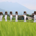 Image of unari (growl) walking rural district on oden feast day